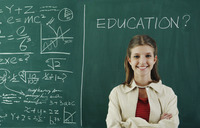 Girl standing in front of the blackboard