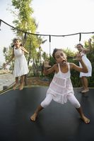 Girls jumping on a trampoline