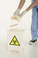 Human hands disposing biohazard waste