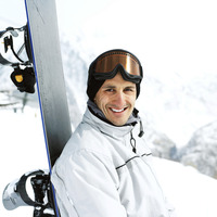 Male snowboarder smiling at the camera