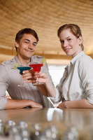 Man and woman drinking at the bar