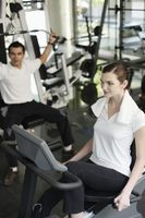 Man and woman exercising in the gymnasium