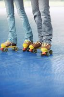 Man and woman roller skating together