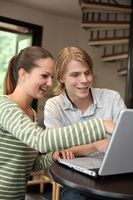 Man and woman sharing a laptop