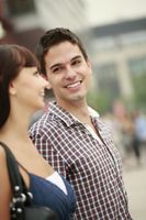Man and woman smiling while looking at each other
