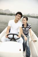 Man and woman traveling on the boat