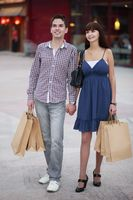 Man and woman with shopping bags
