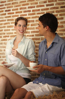 Man and woman with their cups of coffee