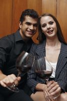 Man and woman with their glasses of wine