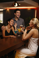 Man and women drinking and chatting at a bar