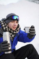 Man drinking hot water on winter day
