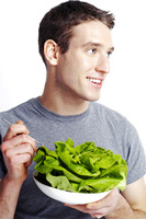 Man holding a bowl of salad
