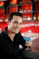 Man holding a glass of cocktail