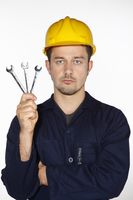 Man holding spanners