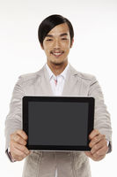 Man holding up a digital tablet