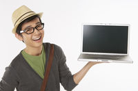 Man holding up a laptop