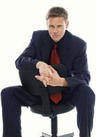 Man in business suit sitting on a chair