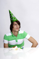 Man in party hat thinking