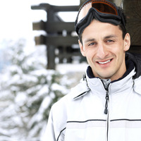 Man in warm clothing and ski goggles