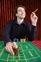Man placing bets on gaming table