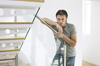 Man posing at the staircase