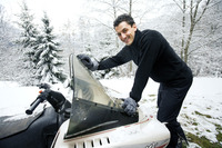 Man riding on snowmobile