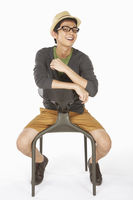Man sitting on the chair, smiling