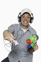Man with headphones playing video game