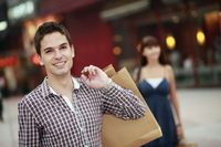 Man with shopping bags smiling