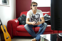 Man with sunglasses sitting on the couch watching movie