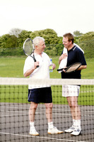 Men chatting in the tennis court