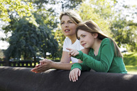 Mother and daughter enjoying the beautiful scenery of the park