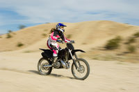 Motocross racer on bike in desert