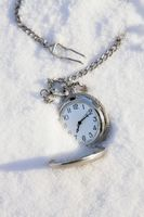 Pocket watch in snow