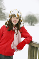 Portrait of girl smiling, wearing a tiger hat