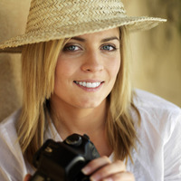 Professional female photographer in straw hat