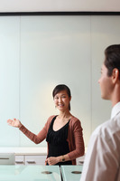 Receptionist greeting businessman