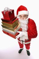 Santa claus holding a stack of presents