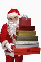 Santa claus with a stack of presents
