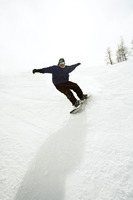 Snowboarder riding downhill