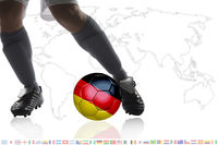 Soccer player dribble a soccer ball with germany flag