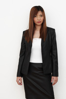 Studio shot of a lady with dyed hair in office attire
