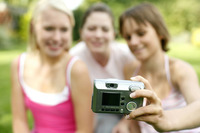 Teenage girls taking picture together