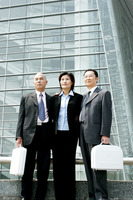 Three business people in office attire