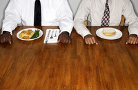 Two businessmen with two different meals