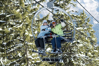 Two women on a snow lift