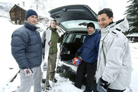 Winter sports player posing beside their jeep