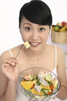 Woman about to eat fruit salad