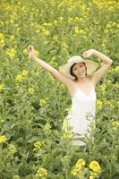 Woman at rape field, smiling