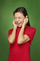 Woman covering ears using her hands